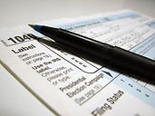 2481-closeup-of-a-1040-tax-form-and-a-pe