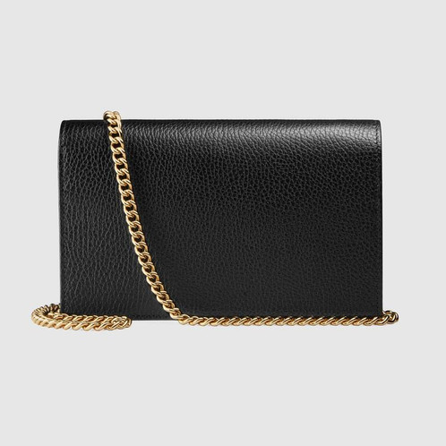 47cb6787f6a1 The elegant GG Marmont mini chain bag has a structured shape in textured  leather. The flap closure features a petite version of the Double G  hardware with ...