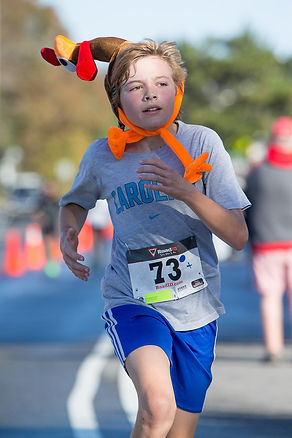 YOUTH RUNNER AT THE ADVICE 5K TURKEY TROT IN DUCK NC