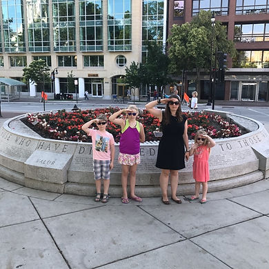 Players hunt for items in the Madison scavenger hunt tour with Operation City Quest