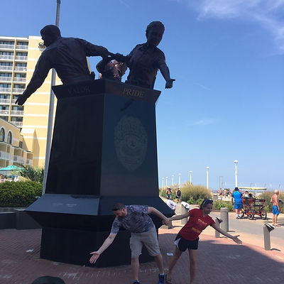 Players hunt for items in the Virginia Beach scavenger hunt tour with Wacky Walks