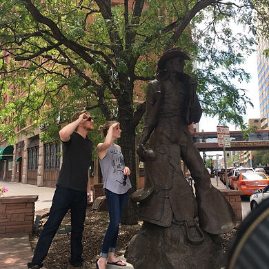 Players hunt for items in the Denver scavenger hunt tour with Operation City Quest