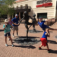 Players hunt for items in the Phoenix scavenger hunt tour with Operation City Quest