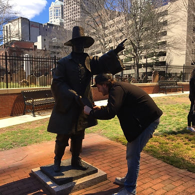 Players hunt for items in the Hartford scavenger hunt tour with Operation City Quest
