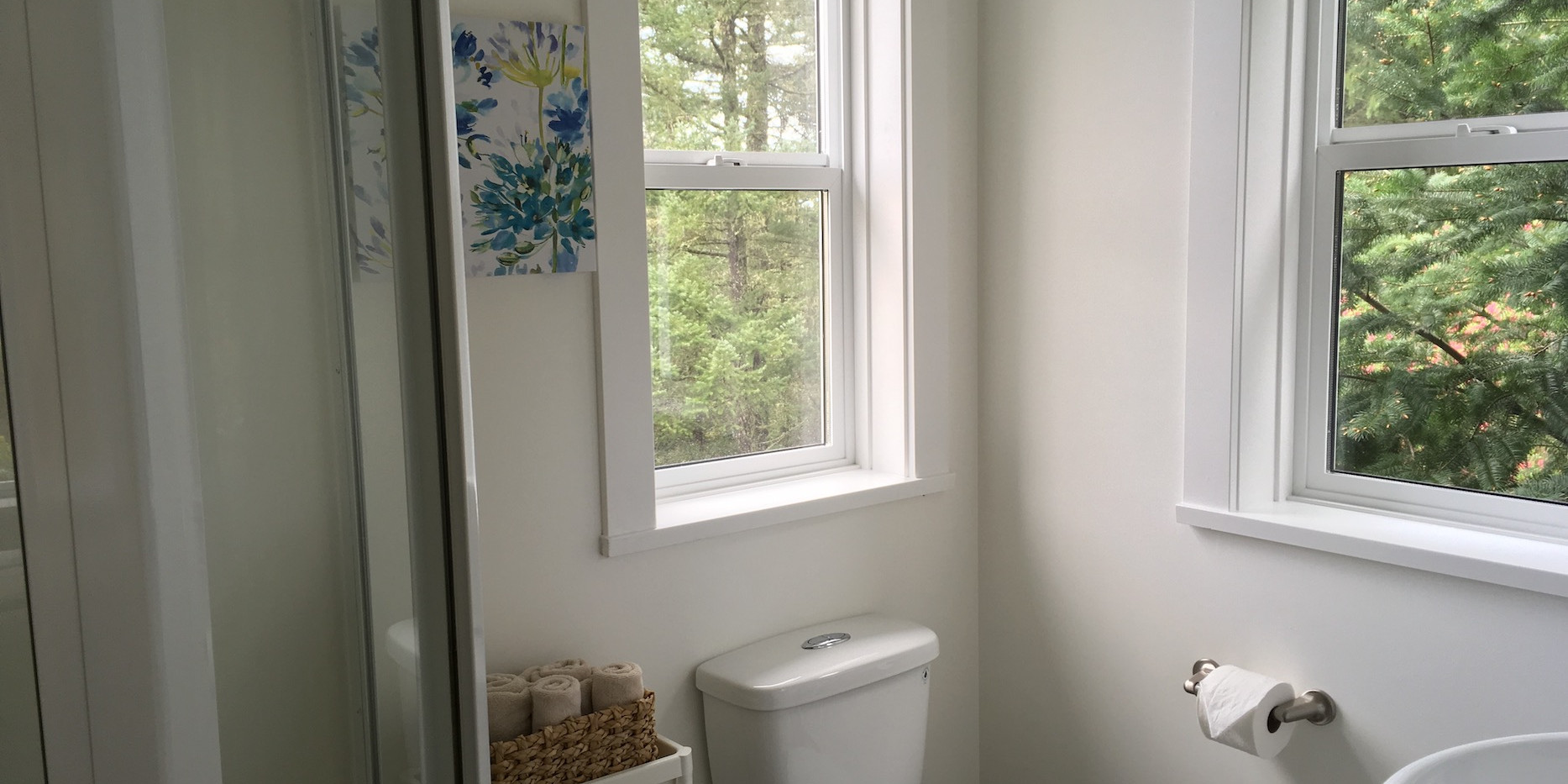 Bathroom with 2 windows in The Small House guest cottage