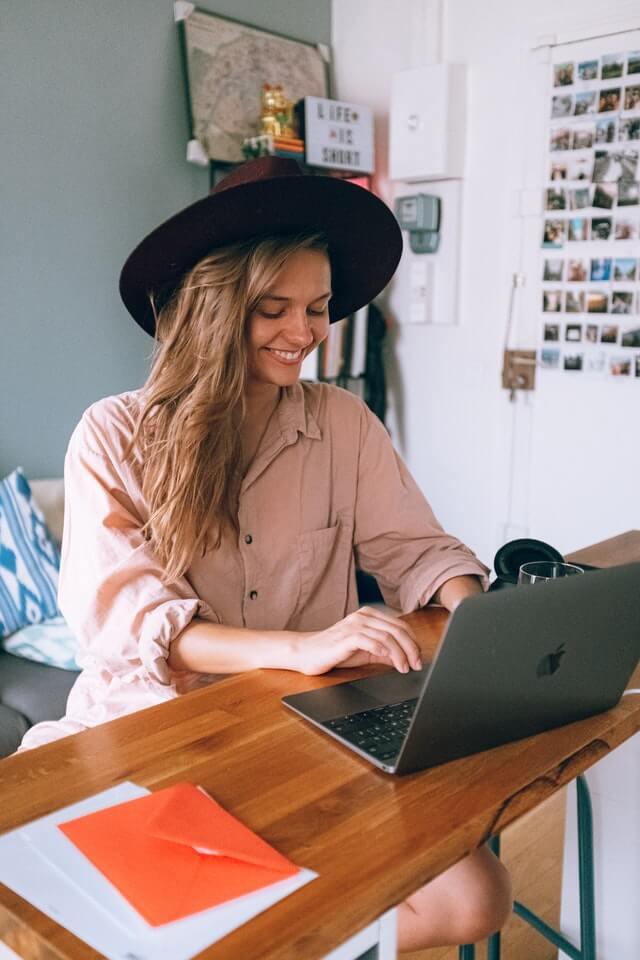 women on computer repurposing content