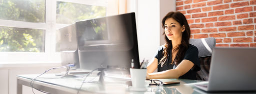 woman-sitting-at-desk-in-front-of-comput