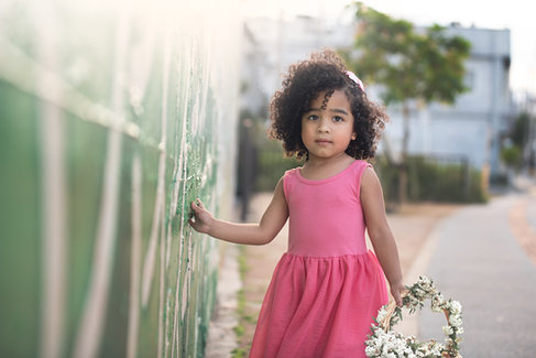 beautiful black child in pink dress holding a flower basket
