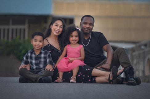 urban family photo posed sitting in street