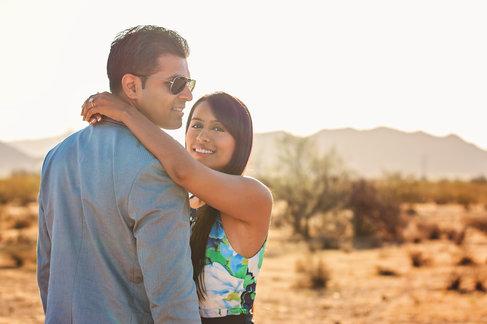 couple posing in sunny desert portrait