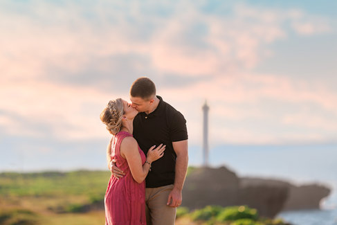 couple kissing at lighthouse cliff