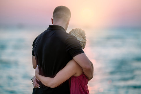 couple embracing at tropical sunset