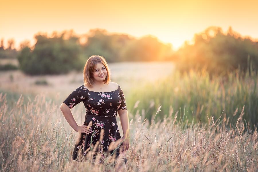 girl in field at golden hour in new bern