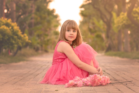 symmetry in child photography little girl in pink dress
