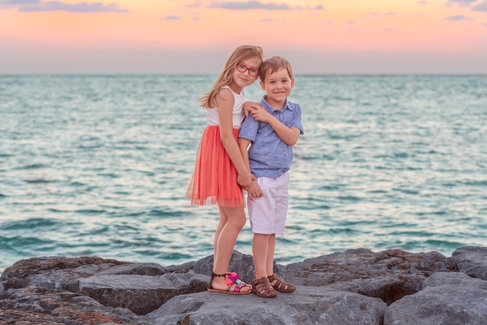brother and sister posing connection at the beach