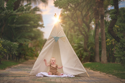 little boy sitting in play tent fine art session