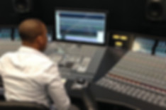 Professional mixing and mastering engineer Michael Cushion Jr working in a recording studio