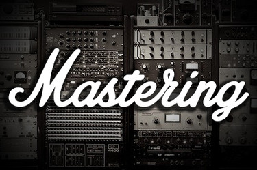 "Collection of audio hardware with the words ""Mastering"" o top"