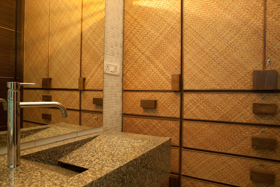 Jute Panelled Cupboards in a Bathroom of