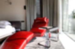 Red_Chaise_Lounge_in_the_Bedroom_of_a_Mo