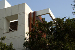 Exterior_shot_showing_the_wooden_members_on_the_outer_facade_of_the_modern_india