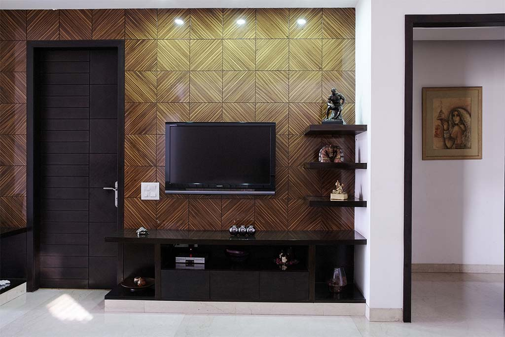 Wall_cladded_with_tiles_complementing_the_wood_work_highlighted_by_spot_lights_i