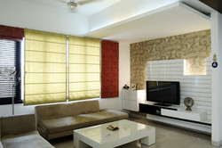 Family_Lounge_with_Wallpaper_behind_the_TV_Console_in_a_Modern_Indian_Home_with_