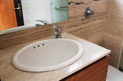 Detail_View_of_the_Bathroom_with_Italian_Marble_of_Modern_Indian_Home_with_Conte