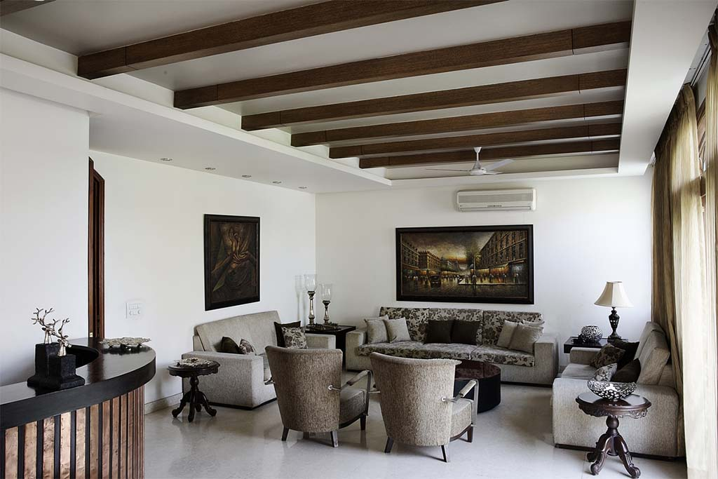 Wooden_bands_running_through_the_ceiling_in_the_living_room_of_a_modern_indian_h
