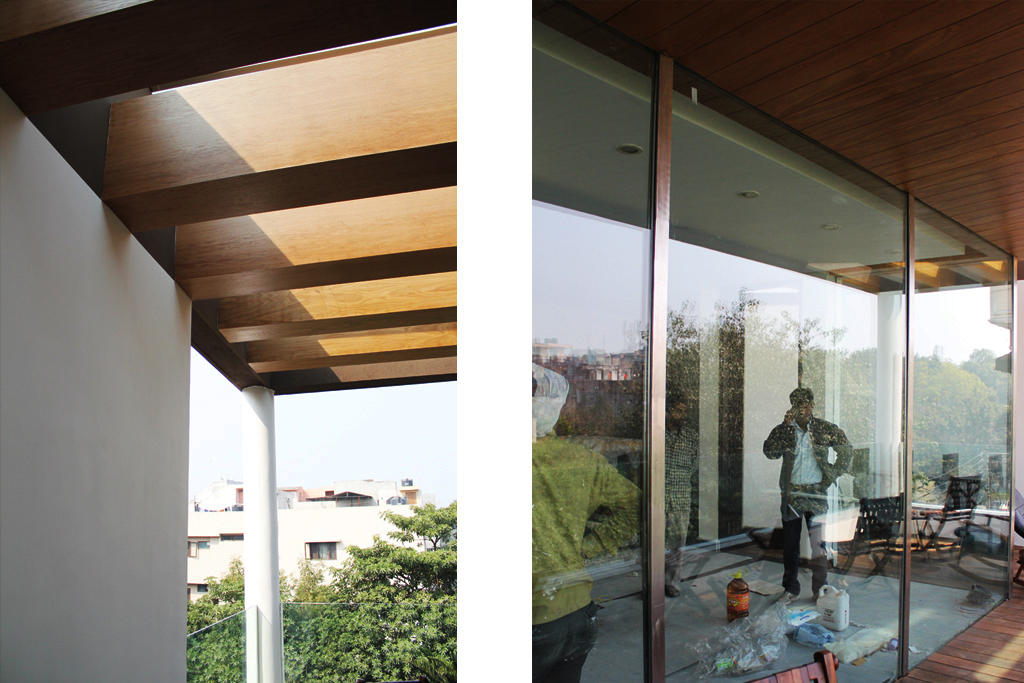 Twin_Exterior_Views_of_the_Upper_Floor_Wooden_Deck_of_Modern_Indian_Home_with_Co