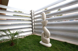 Sculpture_surrounded_by_Operable_Aluminum_Screen_on_the__Green_Roof_of_a_Modern_