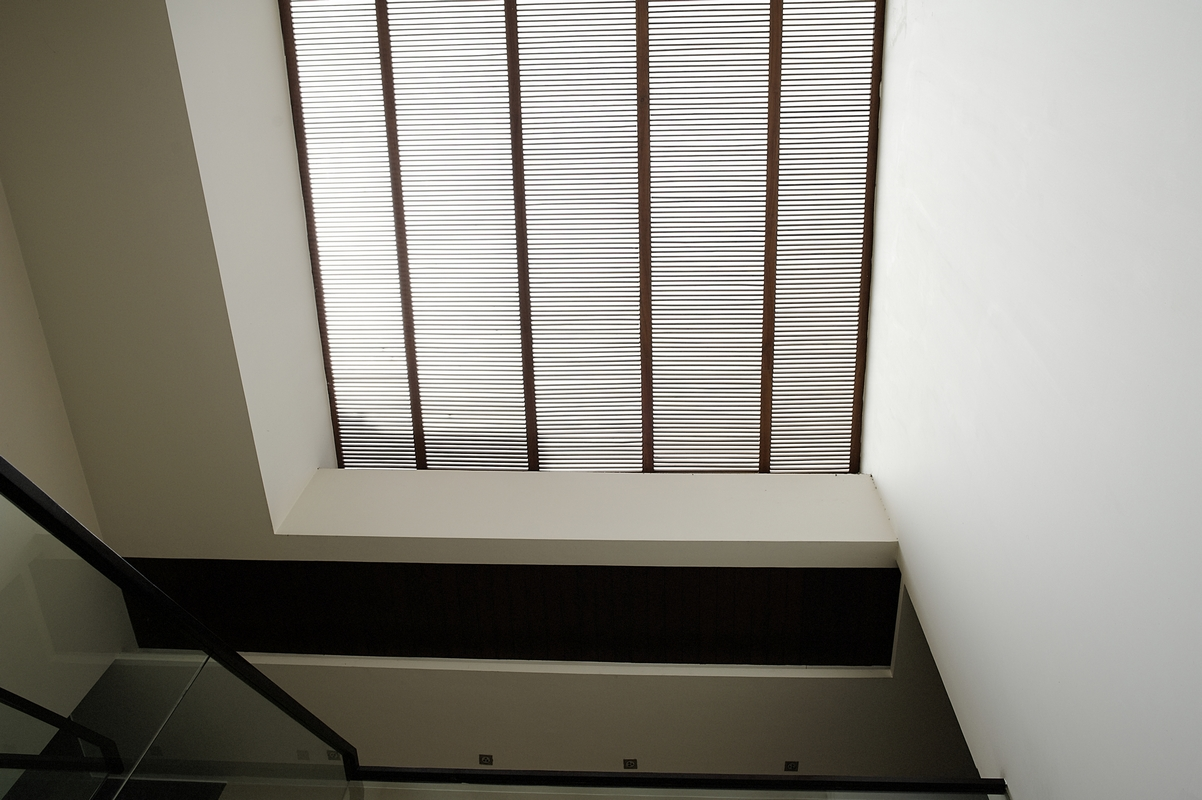 Looking_up_at_Wooden_Slatted_Louvres_below_a_Frosted_Glass_Skylight_in_a_Modern_