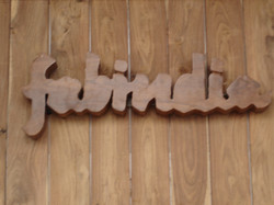 shop logo carved from a single piece of wood.JPG