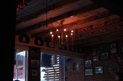 Chandeliers_and_lights_suspended_from_the_wooden_ceiling_brightening_and_warming