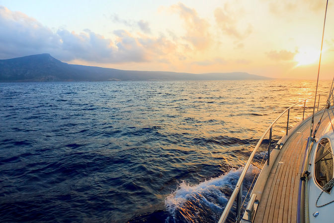 View-from-a-boat-at-sea-at-sunset-156415967_4752x3168.jpeg