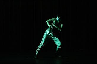 Pierre-Marc Ouellette 2020, dancer in green light leaning in a lunge.jpeg