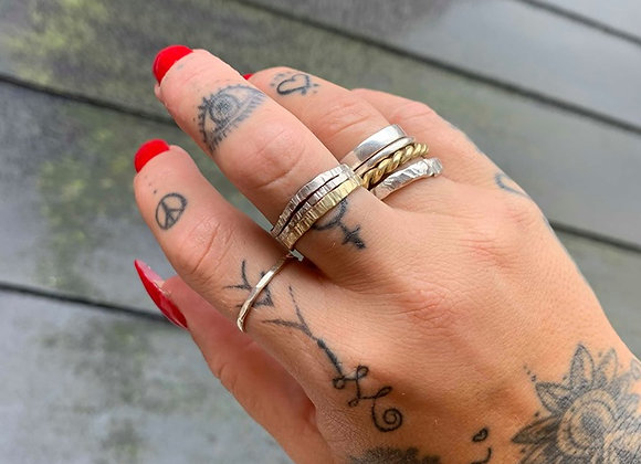 Adjustable silver and brass ring