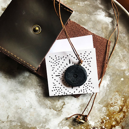 Black Disc with Tan Cord and leather pouch