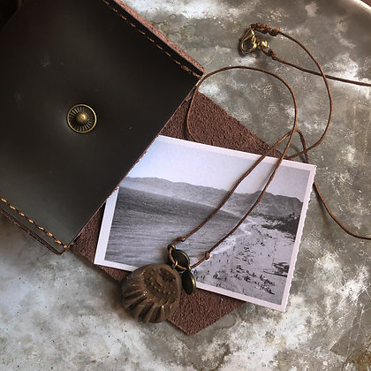 Brown Pendant with brass discs cord and leather Pouch
