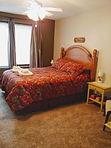 Monk Suite Queen Sleeping Room.jpg