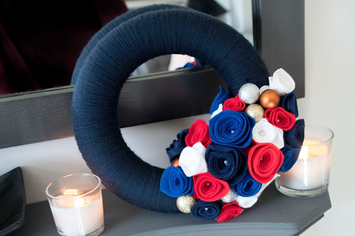 Blue Wool Wreath with Red, White and Blue flowers.
