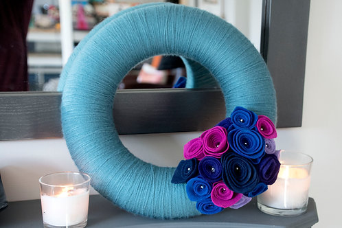 Teal Wool Wreath with Pink, Blue and Purple Flowers