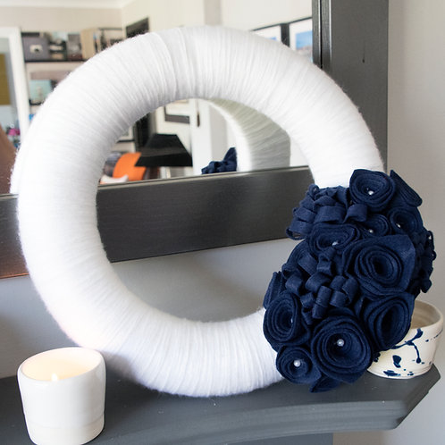 White Wool Wreath with Navy Blue Flowers