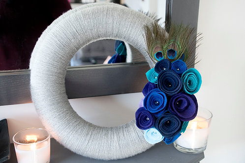 Grey Wool Wreath with Blue, Purple and Turquoise Flowers and Peacock Feathers