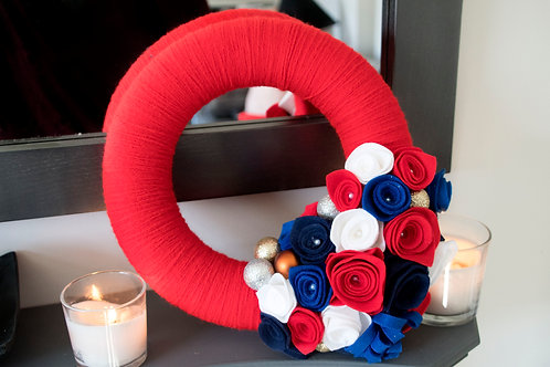 Red Wool Wreath with Red, White and Blue Flowers.