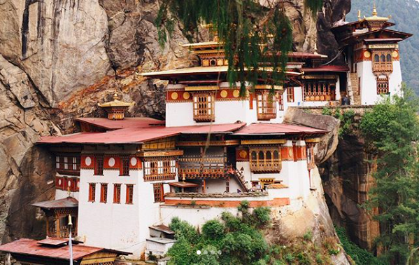 """""""Tiger's Nest is arguably Bhutan's most iconic site for its breathtaking, cliffside views and rich history. We hiked for two hours one way and it was definitely worth it!"""" Photo and caption by students McKenzie Cowbelk and Anne DeLong, from the CIS program Exploring Happiness: Religion and Culture in Bhutan."""