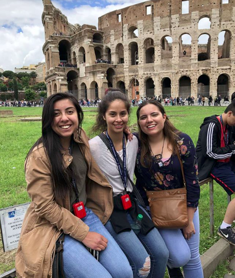 OU in Arezzo engineering students and members of OU Society for Hispanic Professional Engineers (SHPE) pose by the Colosseum in Rome.