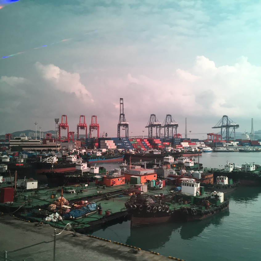 This is a ship yard in Busan. I took the picture because this density of ships  and travel containers went on for a long stretch of the coast in this area.