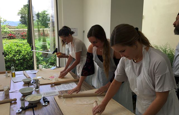 A group of Health and Nutritional Sciences students make pasta during a May program with OU in Arezzo.