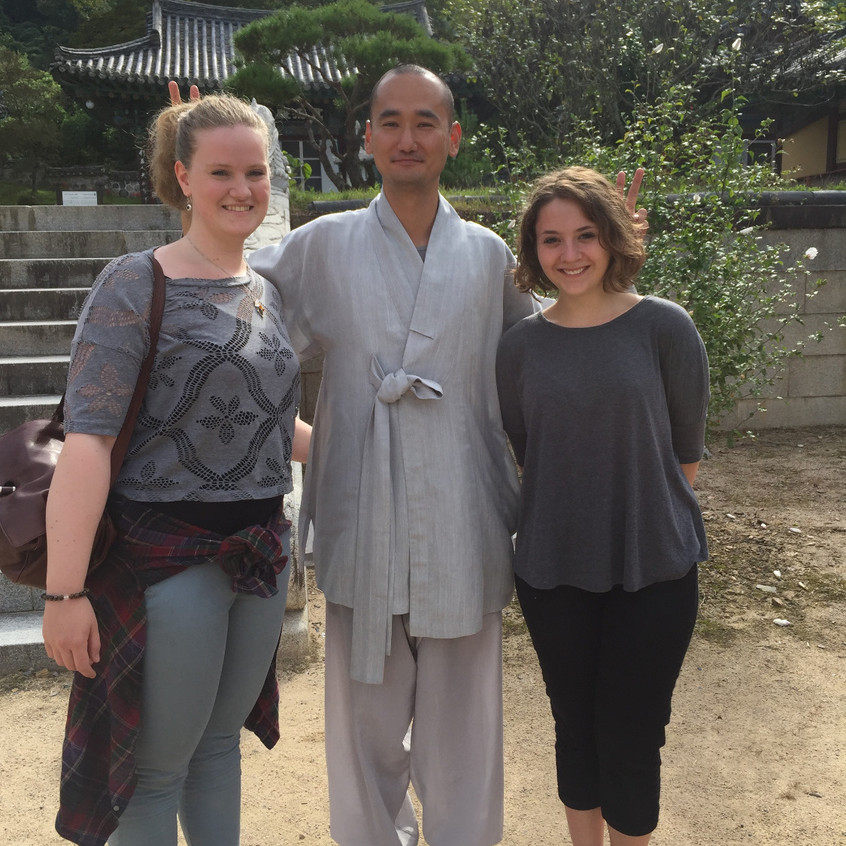 My friend (left) and I (right), taking a picture with a Confucian monk in a rare temple complex that was half old traditions and half new.
